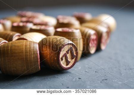 Vintage Lotto Barrels Are Arranged In Random Order On A Dark Surface. 77, 99, 60, 46, 65, 10, 28,43