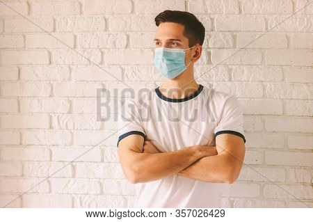 Portrait Young Confident Man In Protective Medical Face Mask And Arms Crossed. Professional Doctor W