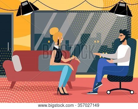 Anchorman Sitting In Rolling Armchair Speaking With Woman Celebrity Guest Sitting On Comfortable Sof
