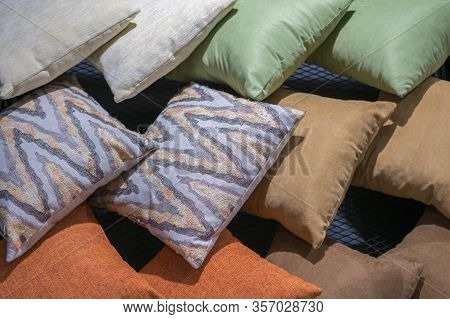 Multi-colored Pillows Background. Creative Background Made Of Pillows. Purple, Blue, Beige, Gray Pil
