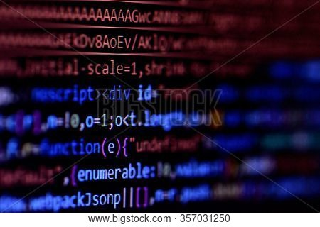 Close-up Of Minified Javascript File. Computer Programming Source Code For Html Website Development.