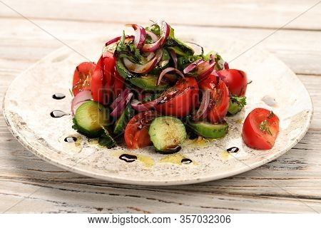 Spring-summer Salad Of Tomatoes, Cucumbers, Red Onions, With Dill, Cilantro And Blue Basil, Seasoned