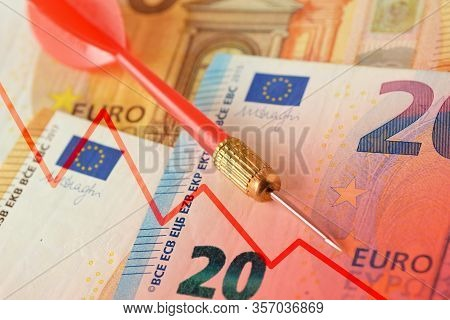 Red Dart And Graphic With Descending Line On Euro Banknotes - Concept Of Lost Money Value