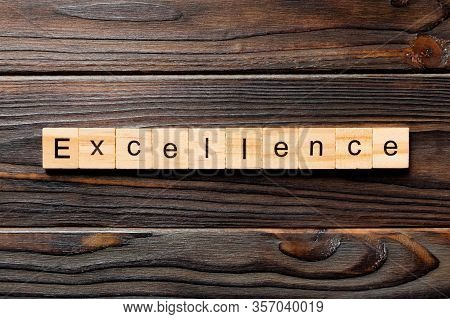 Excellence Word Written On Wood Block. Excellence Text On Wooden Table For Your Desing, Concept