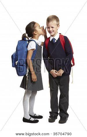 School Girl Whispering In Boys Ear