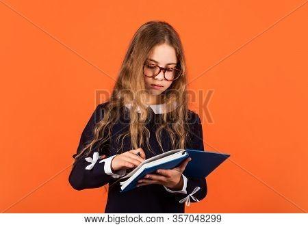 Her First Day At School. Little Girl On September 1. Small Child Do Homework On September 1. Back To