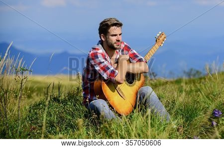 Pleasant Time Alone. Peaceful Mood. Guy With Guitar Contemplate Nature. Wanderlust Concept. Inspirin