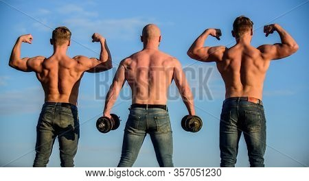Athletic Bodybuilders. Sport Concept. Muscular Body. Muscular Means Powerful. More Strength More Mus