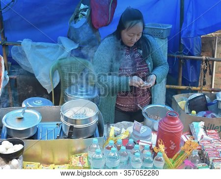 Darjeeling, India- December 27, 2019: An Unidentified Woman Making And Selling Momos And Other Food