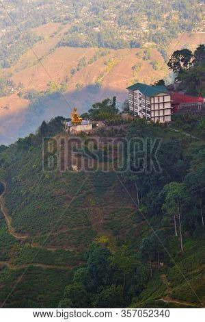 Tea Plantations In Darjeeling, West Bengal, India. Stunning Views Of Hills And A Buddha Statue.