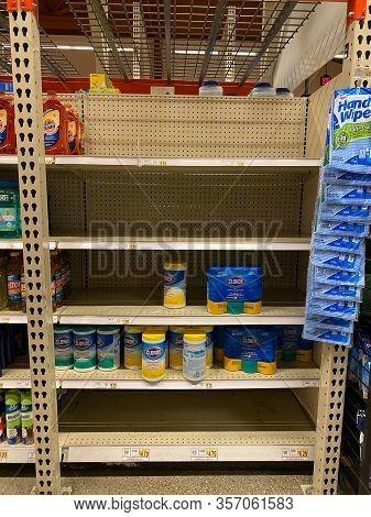 Sanitizing Wipes On Empty Supermarket Shelf