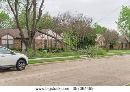 Suburban Street With Parked Car And Fallen Tree Branch Near Dallas, Texas, America