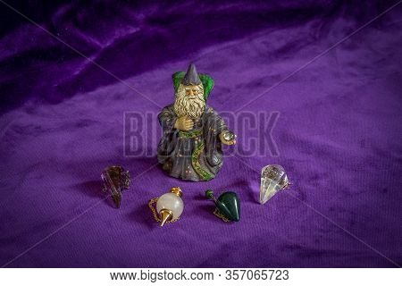 Fortune Telling: Small Wizzard Figure And Four Crystal Dowsing Pendulums