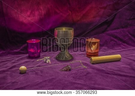 Divining Rod, Crystal Dowsing Pendulus, Candles And A Tin Chalice - Symbols Fortune Telling And Magi
