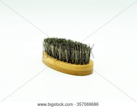 Close Up View Of A Bamboo Beard Brush With Natural Bristles On A White Background In The Center Of T