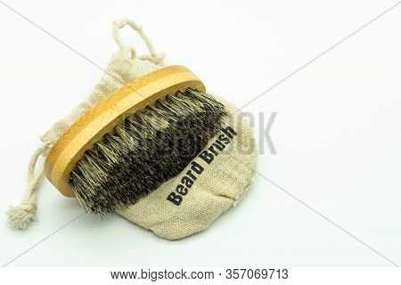 View From Above Of Natural Bristle Beard Brush With Its Cover, On A White Background. Natural Care C