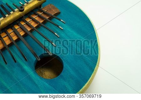 Close-up View Of Blue African Kalimba Made Of Pumpkin, On A White Background With A Small Gap On The