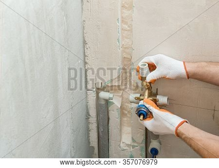 Installation Of Water Pipes In The Wall For The Built-in Shower.