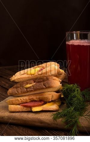 Homemade Sandwiches With Sausage And Cheese. Fresh Juice In A Glass. Greens On A Cutting Board. Wood