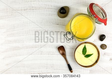 Ghee Or Clarified Butter In Jar. Healthy Eating And Using Organic Fresh Made Products. Healthy Ingre