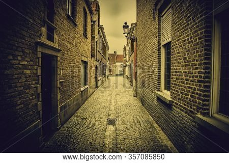 Typical Bruges Alley, Street Detail Of Belgium, Tourism In Europe