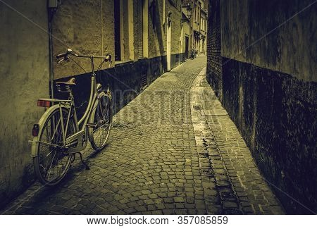 Typical Bicycle In Bruges, Detail Of Transport In Town, Tourism And Exploration Of The City