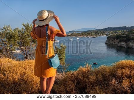 Kastos Island Happy Young Woman In A Yellow Dress And A Straw Hat Enjoying Scenic View Of The Amazin