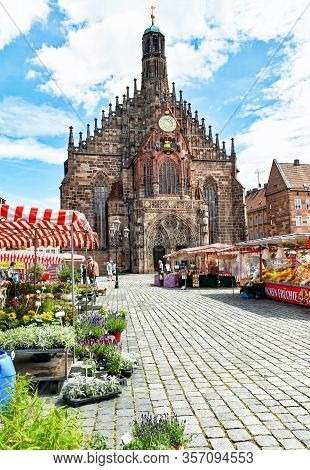 Nuremberg, Germany - June 23, 2018: Market Stalls In Front Of The Church Of Our Lady In The Franconi