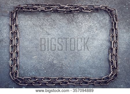Chain Frame On Grunge Leaden Background With Space