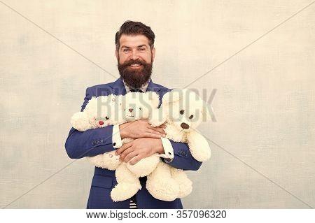 Childish Excitement. Childish Businessman Cuddle Soft Toys. Bearded Man Dream Of Childhood. Childish