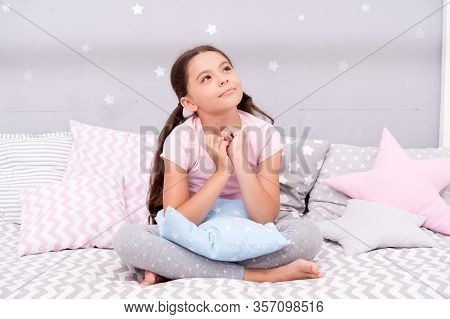 Lost In Thoughts. Serious Girl Thinking In Bed. Little Child With Serious Look. Daydreaming. Flight