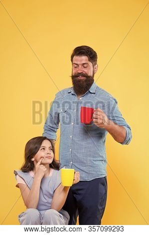 Delicious At First Sip. Happy Family Hold Cups With Delicious Hot Drink. Little Child And Father Enj
