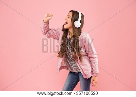 Imagine She Is A Star. Karaoke Party Fun. Fun And Entertainment. Joining In A Song. Small Girl With