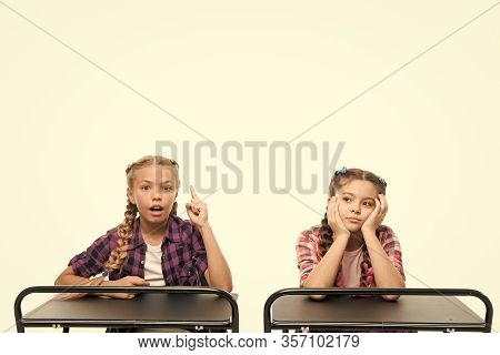 Alternative Education Idea. Cute Children Sitting At Desks Isolated On White. Small Girls Learning I