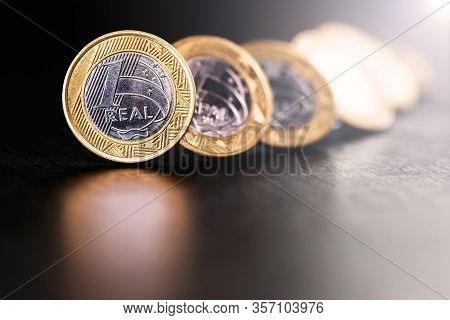 One Real Coin And Gold Bars. Concept Of Appreciation Of The Brazilian Currency In The Stock Market.