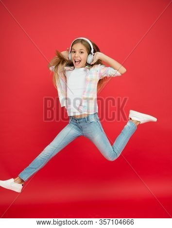 Jumping Mid Air. Easy Listening Music. Small Girl Listening To Music In Headphones. Dancing Girl. Ha