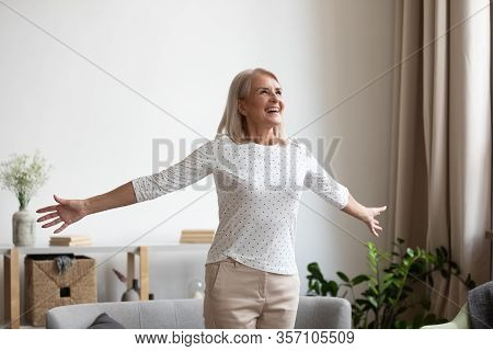 Smiling Older Woman Feeling Thankful For Good Day.