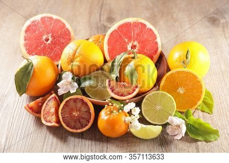 citrus fruit assortment, grapefruit, orange, lemon and leaf