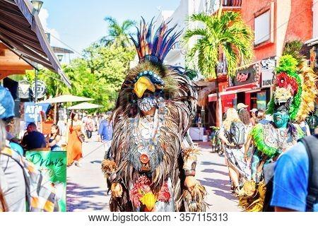 Playa Del Carmen, Mexico - Dec. 26, 2019: Men Dressed In Traditional Indigenous Mayan Warrior Costum