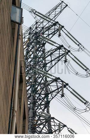 Chongqing, China - May 9, 2010: Downtown. Closeup Of Dark Gray High Voltage Electrical Pylon Cable F