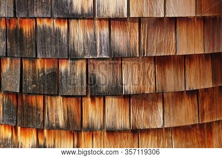Red And Black Cedar Wood Siding Of A Building