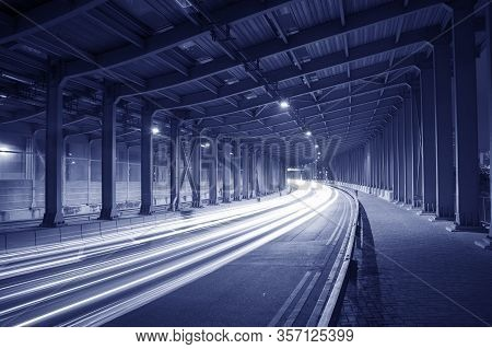 Light Trails And Head Lights Of Traffic In Tunnel
