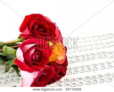 Red rose on note sheet