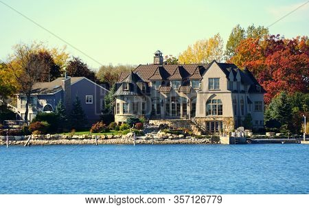 Alexandria Bay, New York, U.s.a - October 24, 2019 - The View Of Waterfront Homes Surrounded By Stri