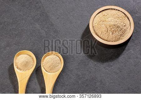 Amla Powder In Wooden Spoons - Phyllanthus Emblica