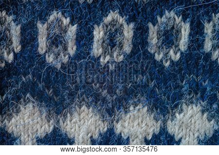 Woolen Pattern Close-up. Detailed Photo Of Interwoven Woolen Threads. Blue And White Threads Made Of