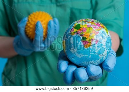 Hands In Medical Gloves Hold A Mockup Of Planet Earth In The Foreground And A Mockup Of The Virus In
