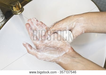 Unrecognizable Person Washing Hands, Rubbing With Soap In Sink Under Water. Hand Disinfection. Close