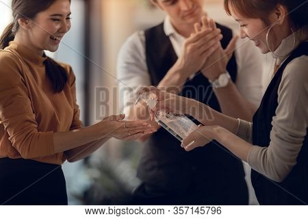 Covid-19 Or Corona Virus Situation In Business Concept. Business People Keep Hand Clean With An Alco