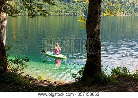 Bohinj, Slovenia - August, 01: Girl Kayaking In The Scenic Bohinj Lake On August 01, 2019